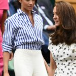 Meghan Markle Her blue and white shirt bunched as she walked Photo (C) GETTY