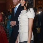Meghan Markle The Duchess of Sussex wore a clutch bag, like Kate Middleton often does Photo (C) GETTY