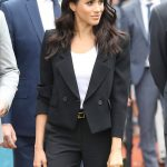 Meghan Markle looked smart in black tailored suit Photo (C) GETTY
