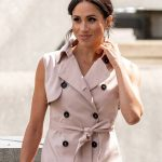 Meghan Markle looked stunning in a pink trench dress Photo (C) GETTY