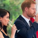 Meghan Markle news Meghan tilts the glass of champagne towards her mouth Photo (C) GETTY