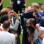 Meghan Markle news Prince Harry gives a high five to Walter Kieran, three, while at Croke Park Photo (C) PA