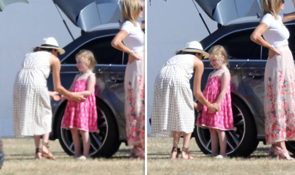 Meghan Markle proved she was natural with children Photo (C) SPLASH