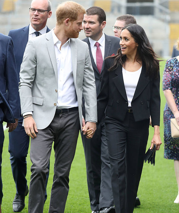 Meghan and Harry hold hands as they tour Croke Park Photo (C) GETTY