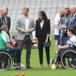 Meghan and Harry speak to players who are involved in community outreach projects at Croke Park Photo (C) GETTY