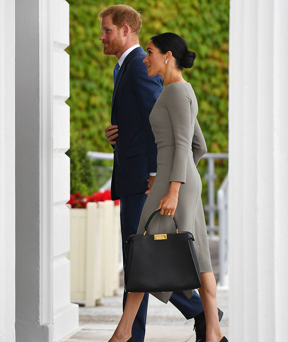 Meghan and Harry walked hand in hand Photo (C) PA