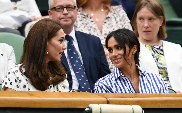 Meghan and Kate laugh during Wimbledon Photo (C) GETTY