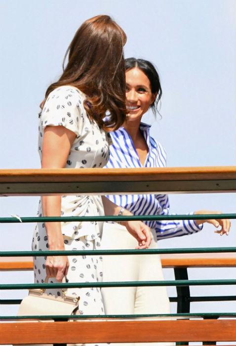 Stunning Duchess Meghan wows Wimbledon in Ralph Lauren to watch bestie Serena Williams in the final Photo (C) GETTY