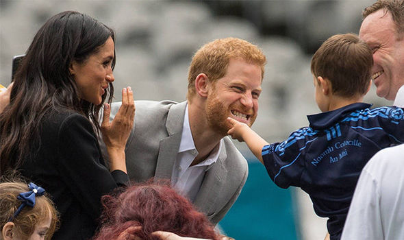 Meghan laughs as Prince Harry jokingly tells Walter off Photo (C) GETTY