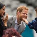 Meghan cooed as Prince Harry teased a little boy who attempted to stroke his beard Photo (C) PA