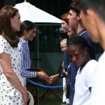 Meghan got to meet the girl doing the coin toss for Serena Williams' match Photo (C) PA