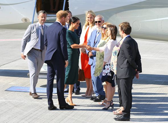 Meghan shakes hands as she has landed in Dublin City Airport