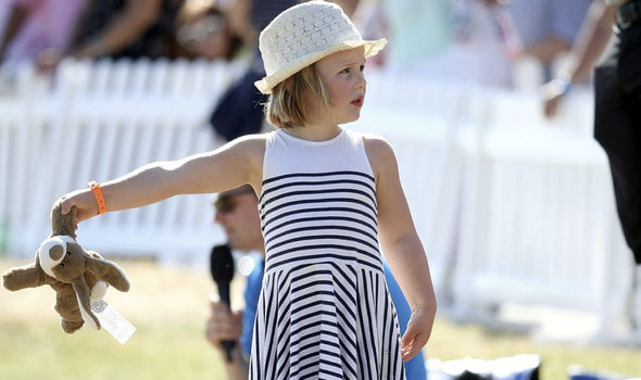 Mia looked adorable in her black and white striped dress and trainers Photo (C) Mike Marsland, WireImage