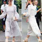 Pippa Middleton completed her Wimbledon look with a pair of cream wedges and round framed sunglasses Photo (C) GETTY