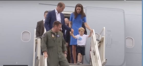 Prince George is very happy with his sticker on a trip to Fairford