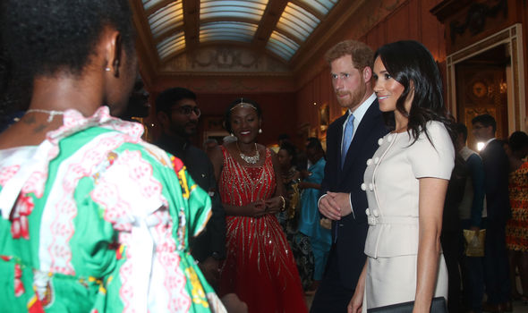 Prince Harry and Meghan Markle attended the Young Leaders Reception at Buckingham Palace Photo (C) GETTY