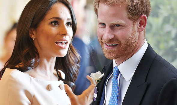 Prince Harry moved his hand away after Meghan Markle tried reach out to him Photo (C) GETTY