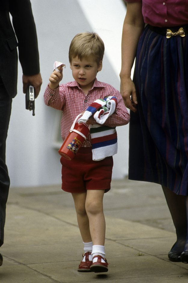 Prince George wears a navy blue pair of shorts with a black belt [Wenn]