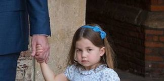Princess Charlotte, three, looked adorable in her blue floral frock with matching hairband, clutching the order of service as she left the chapel with dad William. Photo (C) PA