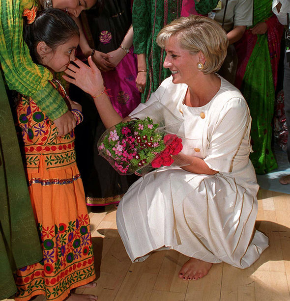 Princess Diana hugging a child during a visit to a Hindu Temple in London Photo (C) GETTY