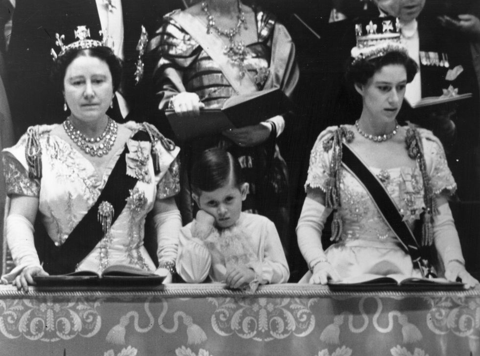 QUEEN ELIZABETH THE QUEEN MOTHER, PRINCE CHARLES, AND PRINCESS MARGARET. PHOTO (C) GETTY IMAGESTOPICAL PRESS AGENCY