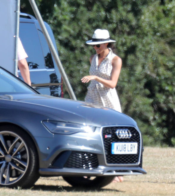 The Duchess attempted to shy away from cameras, but was spotted cheering on Harry and William Photo (C) SPLASHNEWS COM