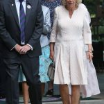 The Duchess of Cornwall was escorted by Philip Brook, chairman of the All England Lawn Tennis Club Photo (C) PA