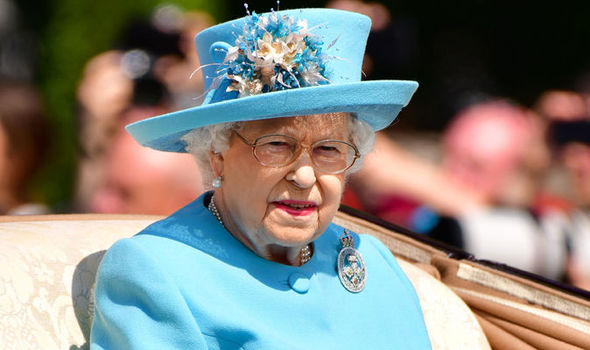 The Queen once hid behind a bush to avoid a guest, a royal author has said Photo (C) Getty Images