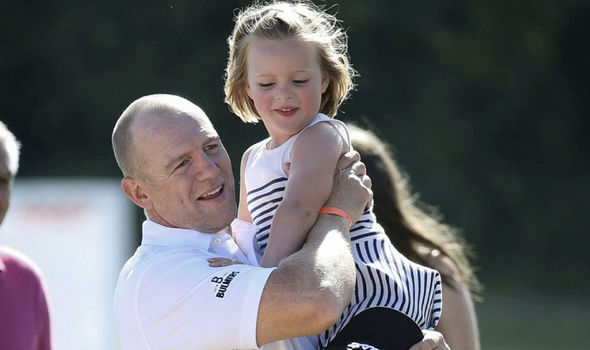 The former English rugby player pecked his daughter on the cheek as he carried her down the course Photo (C) Mike Marsland, WireImage