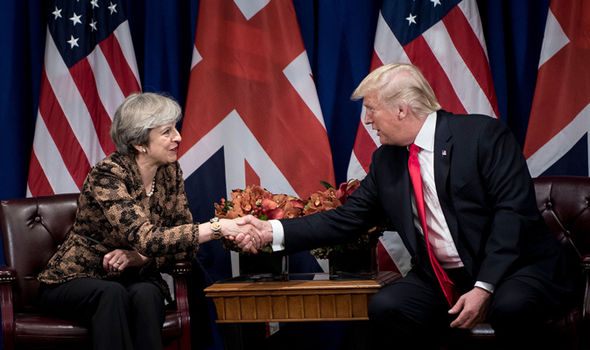Theresa May promised Donald Trump a state visit when he first became president. Photo (C) GETTY
