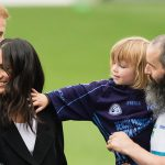 Walter, 3, took a shine to Meghan as he attempted to stroke her hair Photo (C) WIRE IMAGE