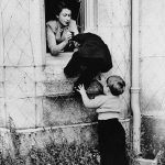 Elizabeth assists little Princess Anne through a castle window in 1953 (Image GETTY IMAGES)