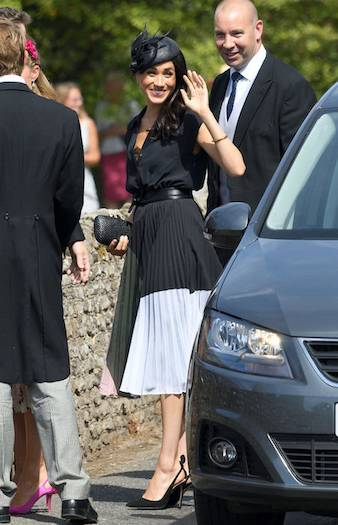 The Duchess of Sussex, who celebrated her 37th birthday on Saturday, was dressed perfectly for the summer weather in her floaty midi skirt Photo (C) PA}
