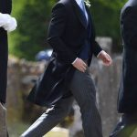 12 Prince Harry took on best man duties and arrived with the groom at the church before the ceremony Photo (C) PA