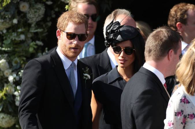 Prince Harry took on best man duties and arrived with the groom at the church before the ceremony Photo (C) PA