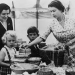 Anne and Charles help their mother set up a cake stall at a sale work event, 1955 (Image GETTY IMAGES)