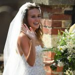 Bride Daisy looked absolutely stunning in her statement wedding dress, which aptly featured tiny floral Photo (C) PA