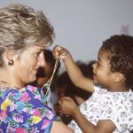 Diana cuddling a child during a visit to a hostel for abandoned children in Brazil (Image Getty Images)