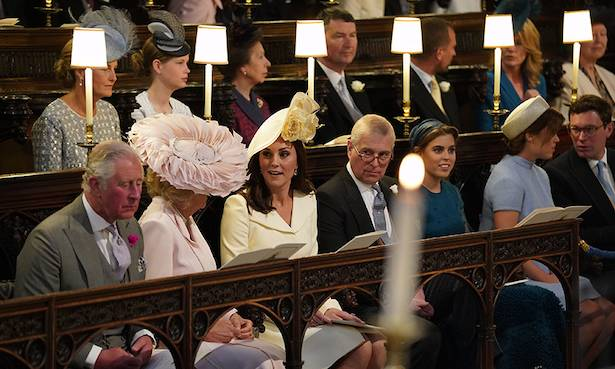 Did we all miss the moment Kate Middleton handed Meghan Markle her wedding bouquet Watch closely Photo (C) GETTY