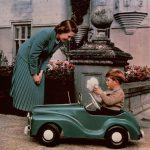 Elizabeth watches her son Prince Charles playing in a toy car, 1952 (Image GETTY IMAGES)