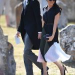Harry and Meghan are spotted walking hand-in-hand as they walk towards the church – both rocking the shades Photo (C) PA