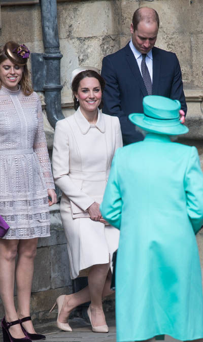 Meghan curtseys while Prince Harry and Prince William bow their heads, following royal tradition (Image GETTY)