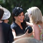 Meghan seemed particularly happy to see one guest, who she pulled into a warm embrace upon seeing her Photo (C) PA