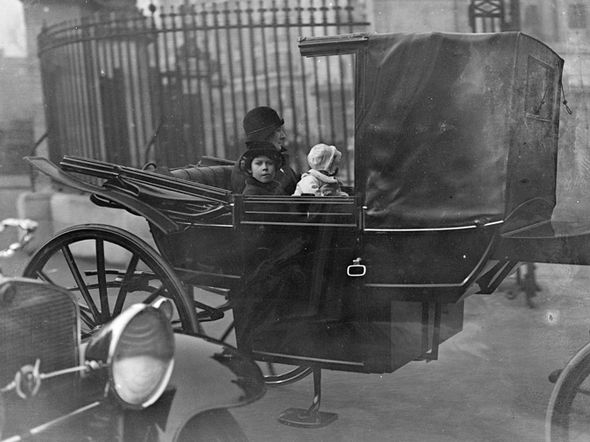 The Queen drives in the spring sunshine in an open carriage accompanied by her sister (Image TopFoto Retronaut mediadrumimages.co)