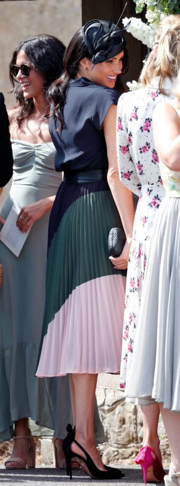 Meghan had a slight slip up with her top button. Photo Getty