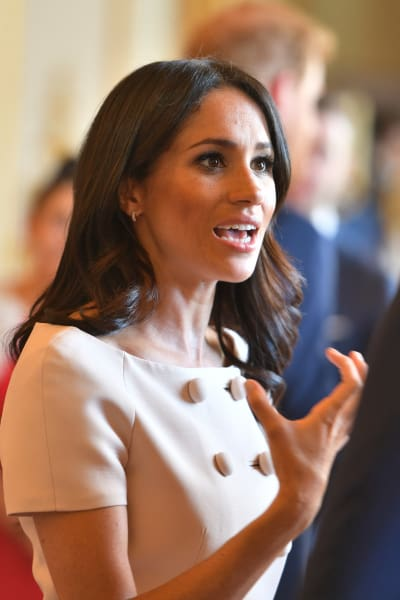 Meghan Markle is cyring and Prince Harry Photo (C) GETTY