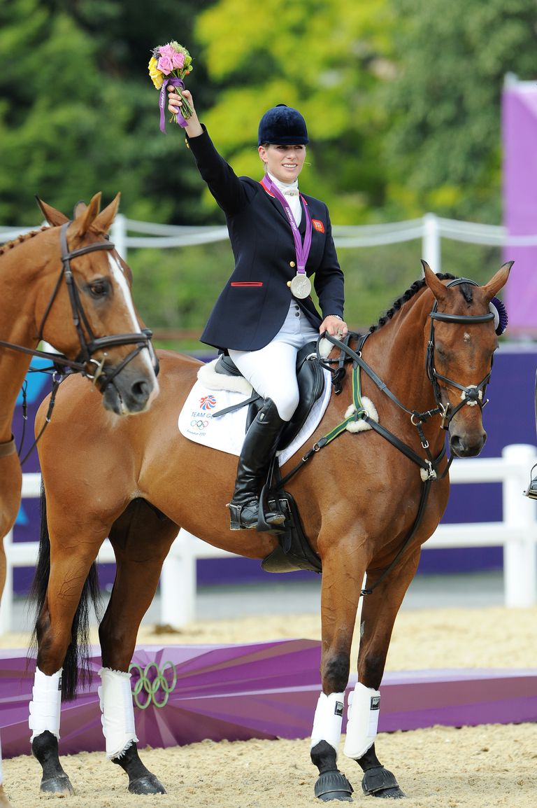 zara-phillips-riding-high-kingdom-waves-to-the-crowd-after-news-photo-149576016-1535044146