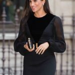 06 The Duchess of Sussex co-ordinated her outfit with a Givenchy dress and matching clutch. Photo (C) PA