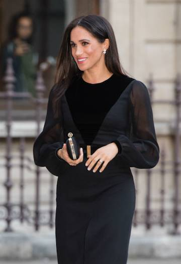 The Duchess of Sussex co-ordinated her outfit with a Givenchy dress and matching clutch. Photo (C) PA