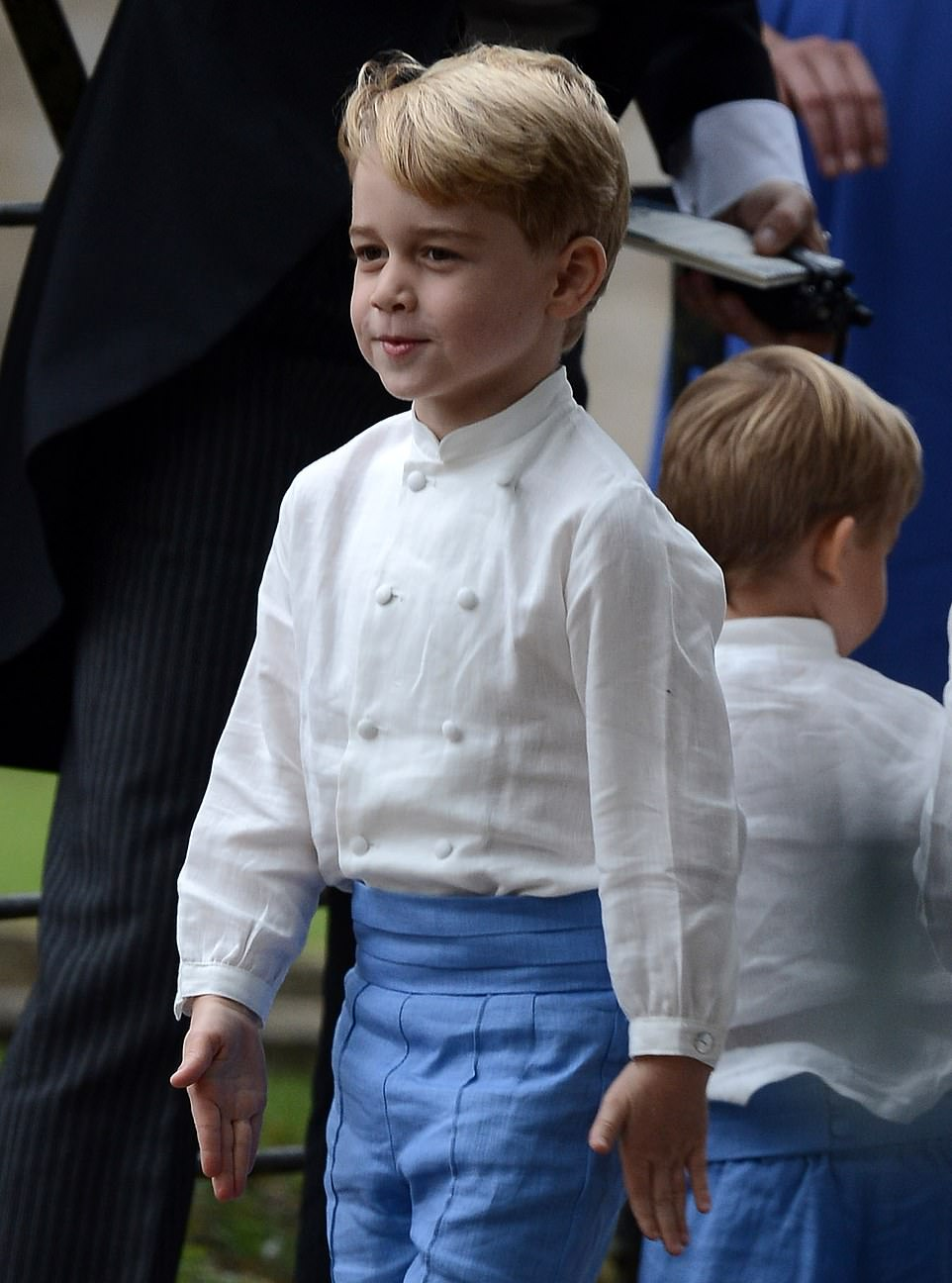 Five-year-old George laughed and giggled at the wedding– and even led his fellow pageboys in a game of soldiers